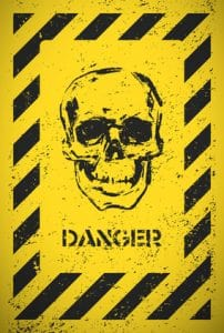 Danger sign with skull. Vector illustration.